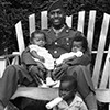 Soldier with children in yard in North Memphis