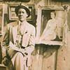 Joseph Delaney seated in front of sidewalk art exhibit