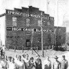 Woolen Mills: Photograph of employees in front of company building